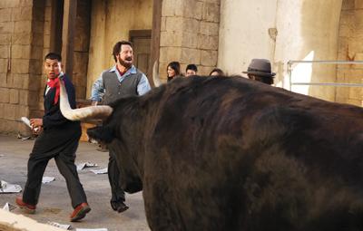 He runs against the bulls.