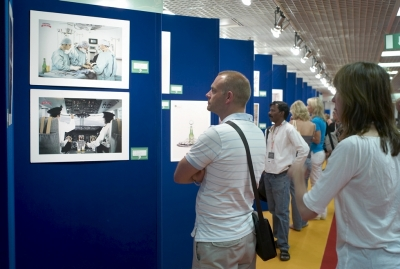 Delegates looking at the exhibition of the work in competition.