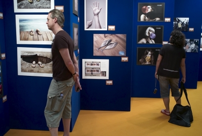 More delegates looking at the exhibition of the work in competition.