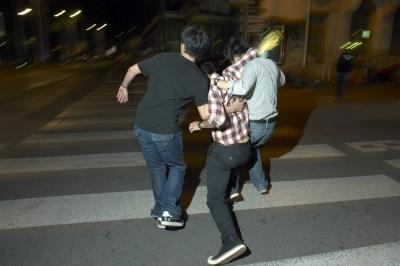 Some Japanese delegates struggle to help their friend home around 3 AM.