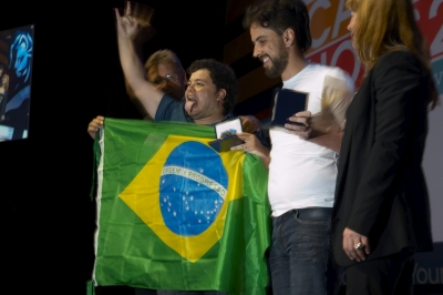 Brazilian winners of the Young Lions Gold, McCann Erickson art director Fabiano de Queiroz Silva and JWT art director Marcelo Mariano Dias, calmly accept the trophy for their Cyber campaign for Unicef.