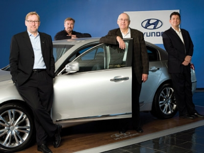 HYUNDAI: Joel Ewanick, Dave Zuchowski, Chris Hosford and Chris Perry stand with a Genesis.