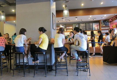 In China, Starbucks is a place to sit back and relax.