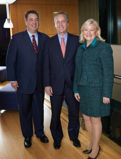 InnovateLTC's John Reinhart, Mayor Greg Fischer and Nucleus President-CEO Vickie Yates Brown.