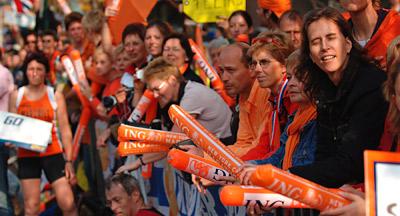 ORANGE PRIDE: Spectators dressed in ING's signature color cheer on runners.