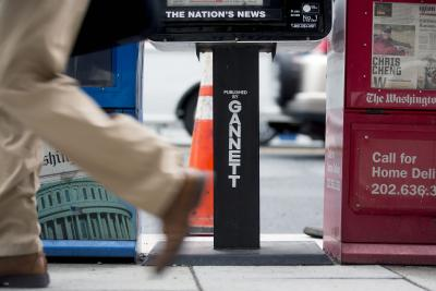 A pedestrian walks past a USA Today newspaper box in Washington, D.C.