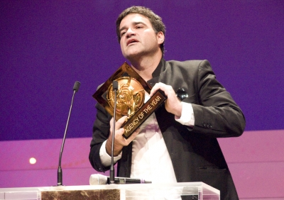 DDB Brasil honcho Sergio Valente goes onstage to claim the Agency of the Year honors