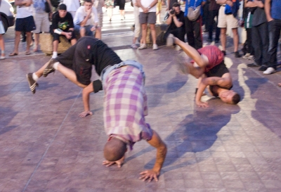 Outside the Palais, breakdancers give a tribute to Michael Jackson.