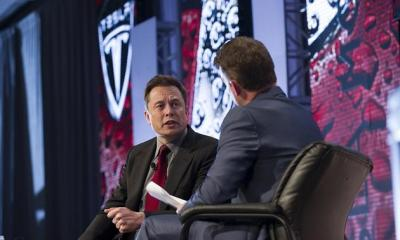 Elon Musk and Automotive News Publisher and Editor Jason Stein