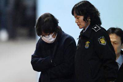Choi Soon-Sil, a confidante of South Korean President Park Geun-Hye, leaves the Central District Court in Seoul, South Korea.