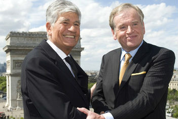 Mr. Levy and Omnicom Group CEO John Wren as the companies' merger was announced