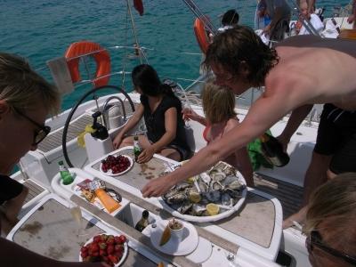 Taking an oyster break aboard the Social Club sailboat