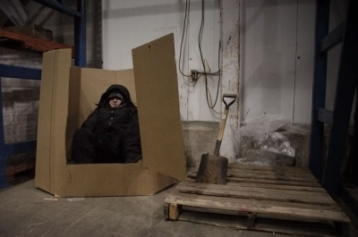 It's hard out there for a creative director. Mykolyn tests the coat in homeless-like conditions (except with an iPod).