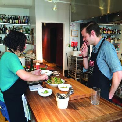 Saveur's Farideh Sadeghin and the author tasting a brown rice salad with avocado.