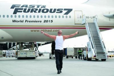 Vin Diesel greets a decked-out Etihad Airways Boeing 777 at Los Angeles International Airport.