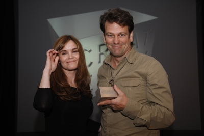 Creativity editor Teressa Iezzi presents Tracey-Locke strategic integration officer Jim Sexton with an award for the agency's work on the Simpsons movie launch