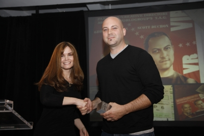Teressa Iezzi gives T.A.G. copywriter Rick Herrera the award for the Halo 3 'Believe' campaign