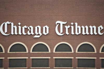 Tribune Co.'s CEO is talking about buying newspapers, not selling.