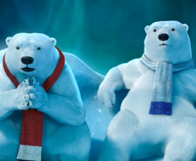 Coca-Cola's polar bears watch the game.