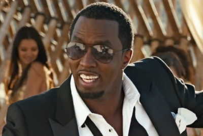 Diddy in a Fiat ad cross-promoting Revolt.
