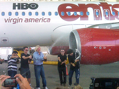 At Virgin America's inaugural flight from JFK today, Richard Branson (center) celebrates with the cast of the HBO series 'Entourage.'