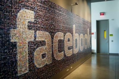 Signage made up of individual faces is displayed inside the Facebook Prineville Data Center in Prineville, Ore.