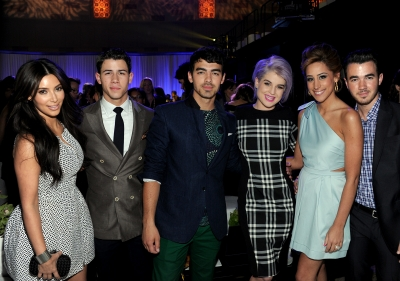 Kim Kardashian, Nick Jonas, Joe Jonas, Kelly Osbourne, Dani Jonas and Kevin Jonas at the E! upfront