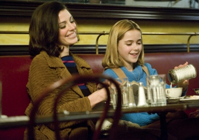 Megan Draper (Jessica Pare) and Sally Draper (Kiernan Shipka)