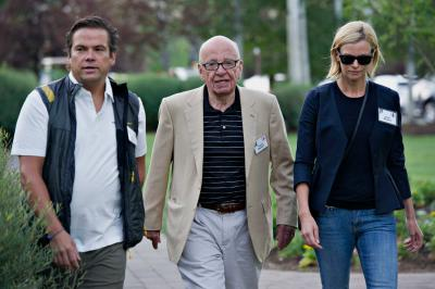 Rupert Murdoch, chairman of 21st Century Fox, walks with Lachlan Murdoch, left, and Sarah Murdoch while arriving for a morning session during the Allen & Co. Media and Technology Conference in Sun Valley, Idaho, on July 10.