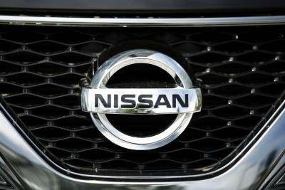 The front grille of a Murano crossover vehicle on display outside Nissan's showroom in Yokohama, Japan, in May.