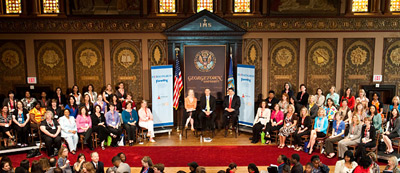 Parenting Editor in Chief Susan Kane joins U.S. Secretary of Education Arne Duncan and Robert Manuel, dean of Georgetown University's School of Continuing Studies, and the 51 Mom delegates at the inaugural Mom Congress on Education and Learning conference.