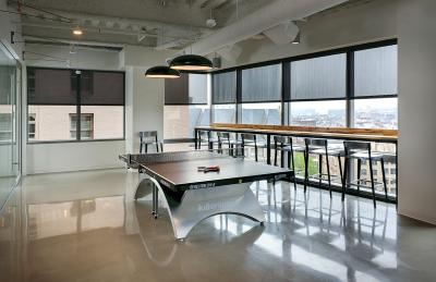 Staples' Seattle e-commerce hub is decked out with a ping-pong table, graffiti-covered walls and large windows overlooking the Puget Sound.