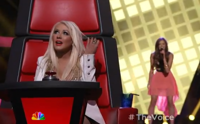 Christina Aguilera listens to a contestant on the third season of 'The Voice'