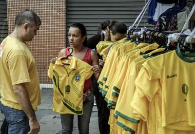 Customers look at Brazilian themed souvenirs in Sao Paulo, Brazil, during the weekend leading up to the World Cup.
