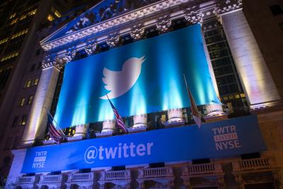 A banner with the Twitter logo hangs outside the New York Stock Exchange in November 2013 as the company went public.
