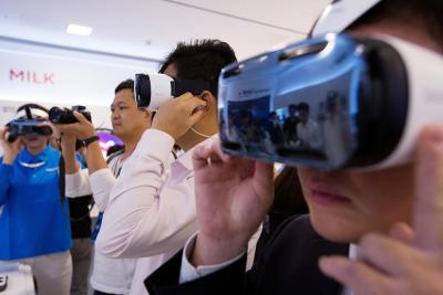 Attendees try out Samsung Galaxy Gear Virtual-Reality headsets, jointly developed by Samsung and Oculus VR, in Seoul.