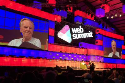 John Sculley talks with David Carr at the Web Summit in Dublin on Tuesday.