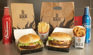 Burger King's plans to open Whopper Bars in Miami and New York City have been put on hold.