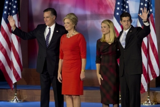 Mitt Romney, Republican presidential candidate, his wife Ann Romney, and his running mate Paul Ryan with his wife Janna Ryan wave to the crowd following Romney's concession speech during an election rally in Bo