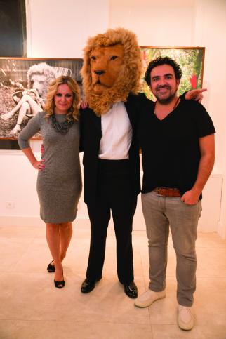 Thais Marin and Leo Macias with guest in lion head