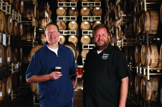 Goose Island CEO Andy Goeler and Brewmaster Brett Porter in one of the brewer's barrel-aging warehouses.