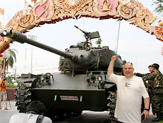 Mark Ingrouille by a government tank one month ago, when the military first moved in and an end to the crisis seemed near.