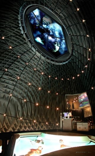 Minority Report. The Precog Chamber is an anechoic chamber for the brain. The Chamber takes the brain patterns of each Precog and projects them as physical intersecting ripple patterns. This was the first film set to use a CNC manufacturing process to translate a digital Maya model into the physical surface of an entire set.