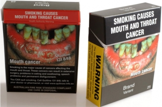 Proposed cigarette packets, to be introduced under Australia's cigarette plain-packaging law, were arranged for a photograph in Melbourne, Australia last year.