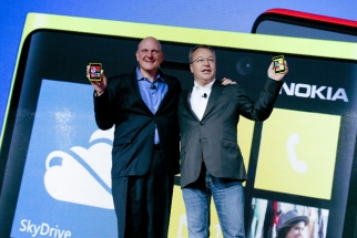 Microsoft CEO Steve Ballmer and Nokia CEO Stephen Elop hold the Nokia Lumia 920 running Windows software in New York on Sept. 5, 2012