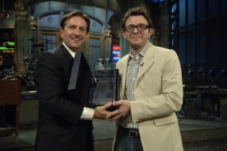 AICP's Matt Miller presents Justin Wilkes with the award
