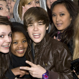 Justin Bieber fans tear themselves away from Twitter for a second.
