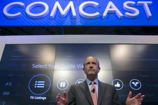 Comcast Chairman-CEO Brian Roberts speaks during a news conference.