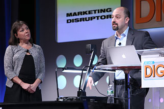 Exec VP-advertising for Shazam, Evan Krauss, address the audience while Old Navy CMO Amy Curtis-McIntyre looks on.