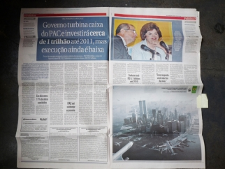 Newspaper with WWF print ad.